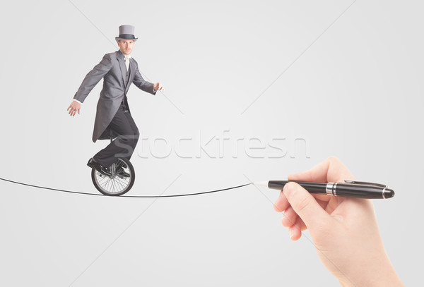 Businessman riding monocycle on a rope drawn by hand Stock photo © ra2studio