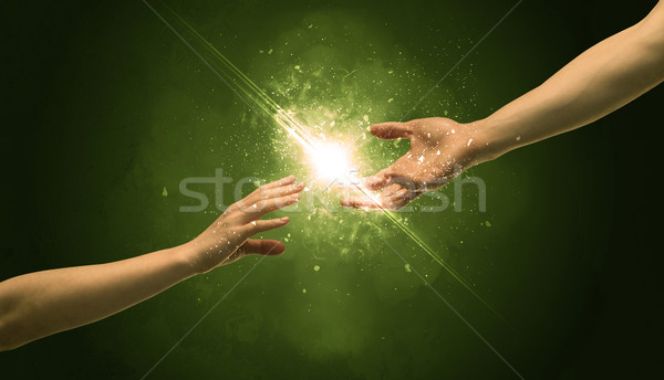 Touching arms lighting spark at fingertip Stock photo © ra2studio