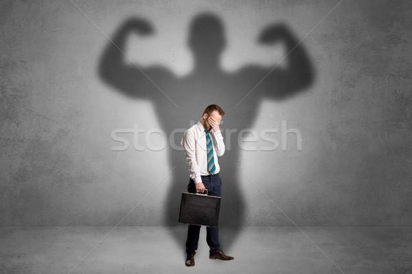 бизнесмен мышечный тень за назад серьезный Сток-фото © ra2studio