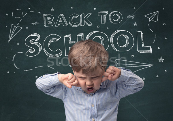 Cute boy with back to school concept Stock photo © ra2studio