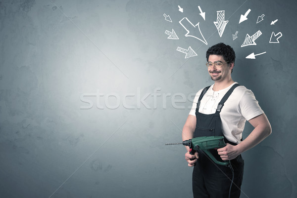 Worker standing with tool. Stock photo © ra2studio