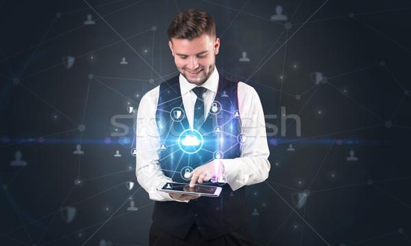 Nuvem empresário comprimido holograma jovem terno Foto stock © ra2studio