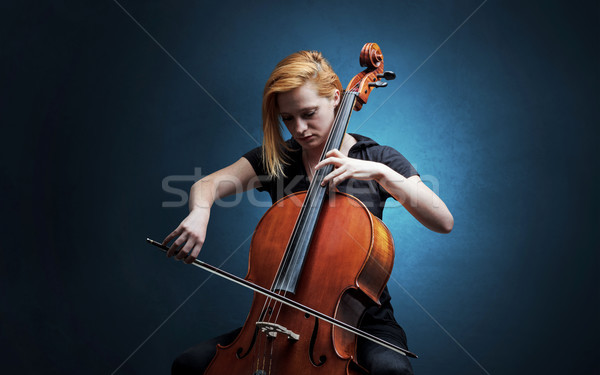 Cellist playing on instrument with empathy Stock photo © ra2studio