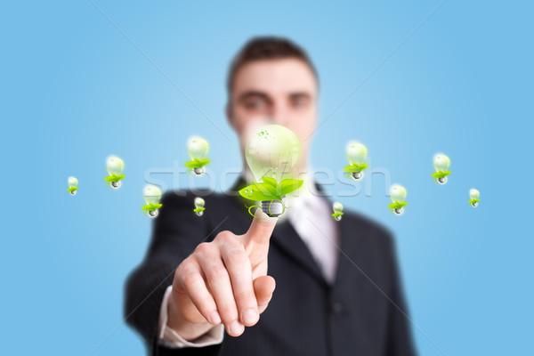 Kéz kisajtolás öko gomb üzletember ház Stock fotó © ra2studio