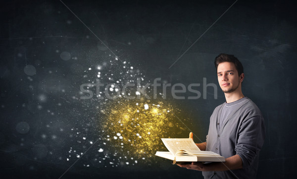 Young guy reading a magical book Stock photo © ra2studio