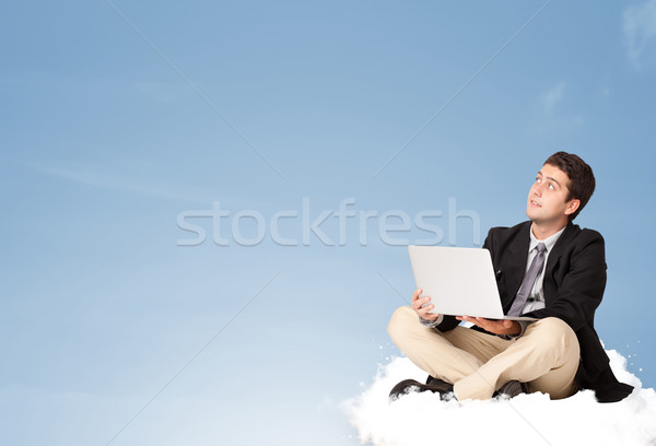 Attractive businessman sitting on cloud with copy space Stock photo © ra2studio