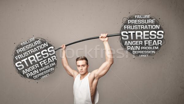 muscular man fighting with stress Stock photo © ra2studio