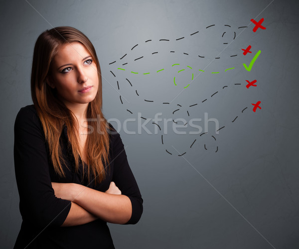 Young woman choosing between right and wrong signs Stock photo © ra2studio