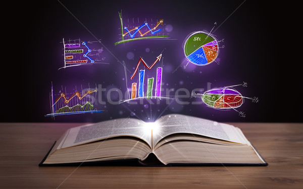 Book on wooden deck with glowing graph illustrations Stock photo © ra2studio