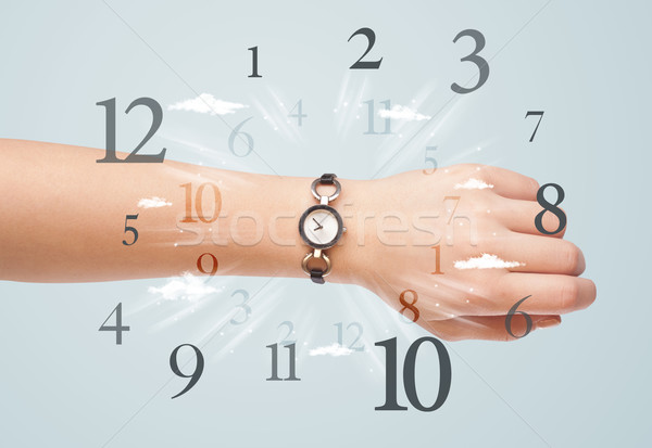 Hand with watch and numbers on the side comming out Stock photo © ra2studio