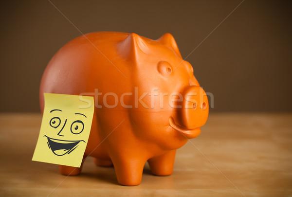 Nota cara sonriente alcancía papel cara Foto stock © ra2studio