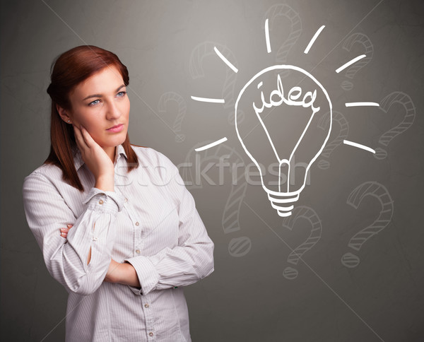 Young girl comming up with a light bubl idea sign Stock photo © ra2studio