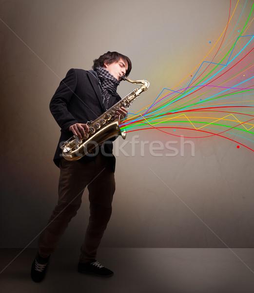 Atraente músico jogar saxofone colorido abstrato Foto stock © ra2studio