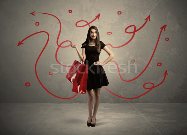 Stock photo: Stylish woman shopping and red arrows