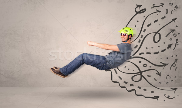 Funny man driving a flying vehicle with hand drawn lines after h Stock photo © ra2studio