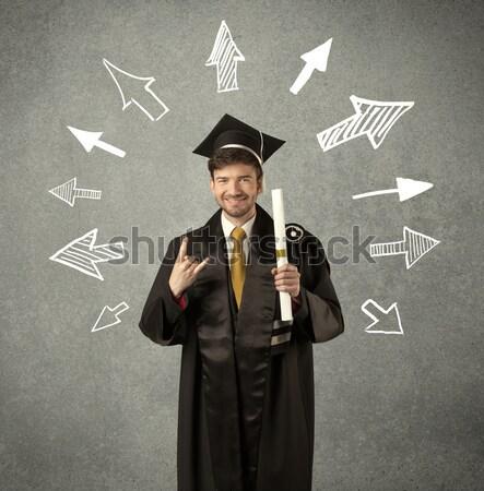 Jonge afgestudeerde student pijlen muur Stockfoto © ra2studio