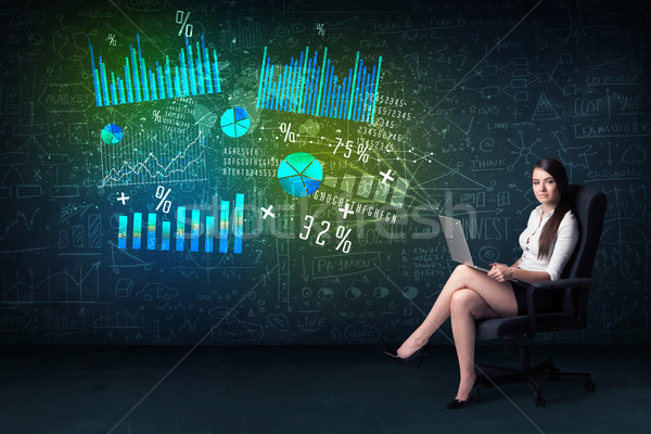 Businesswoman in office with laptop in hand and high tech graph  Stock photo © ra2studio