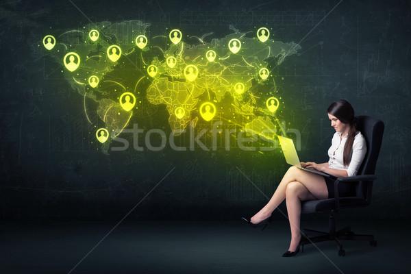 деловая женщина служба ноутбука Мир карта телефон Сток-фото © ra2studio