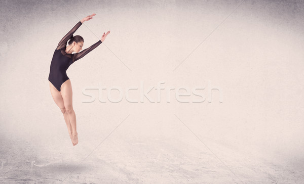 Modern Ballet Dancer Performing Art Jump With Empty Background Stock