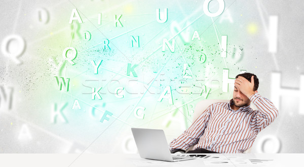 Business man at desk with green word cloud Stock photo © ra2studio