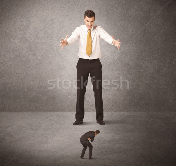 Big business man looking at small worker Stock photo © ra2studio