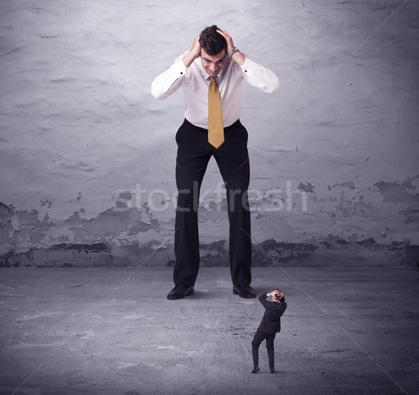 Zangado grande gerente olhando empresa de pequeno porte homem Foto stock © ra2studio
