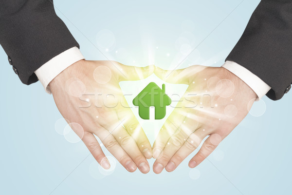 Hands creating a form with green house Stock photo © ra2studio