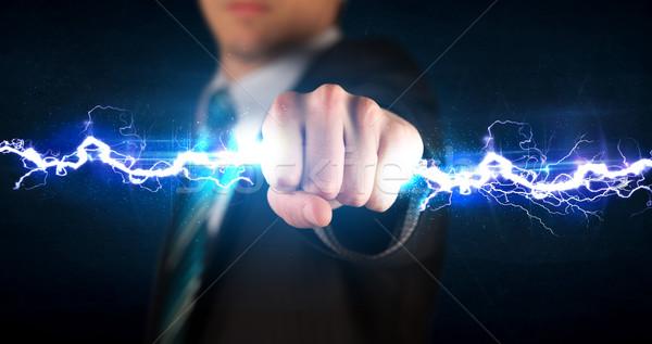 деловой человек электроэнергии свет рук Сток-фото © ra2studio