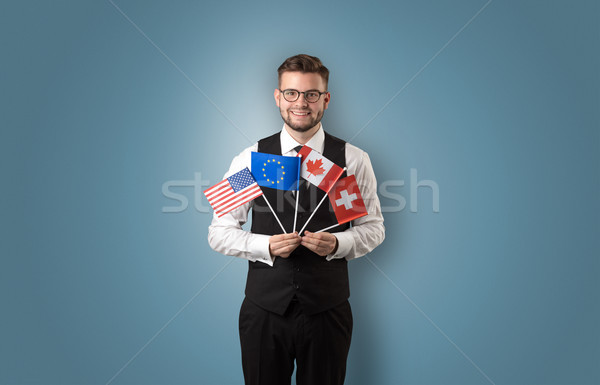 Stock photo: Handsome student standing with national flag