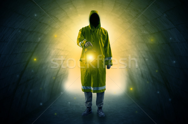 Man walking with lantern in a dark tunnel Stock photo © ra2studio