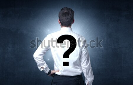 Man standing with question mark on his back Stock photo © ra2studio