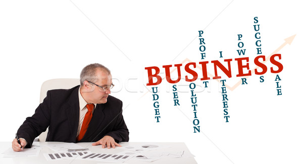 businessman sitting at desk with word cloud Stock photo © ra2studio