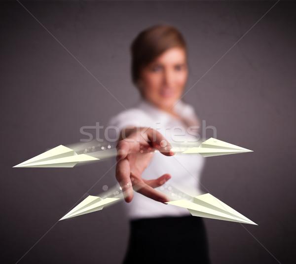 Beautiful lady throwing origami airplanes Stock photo © ra2studio