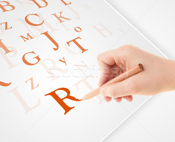 Hand writing various letters on white plain paper Stock photo © ra2studio