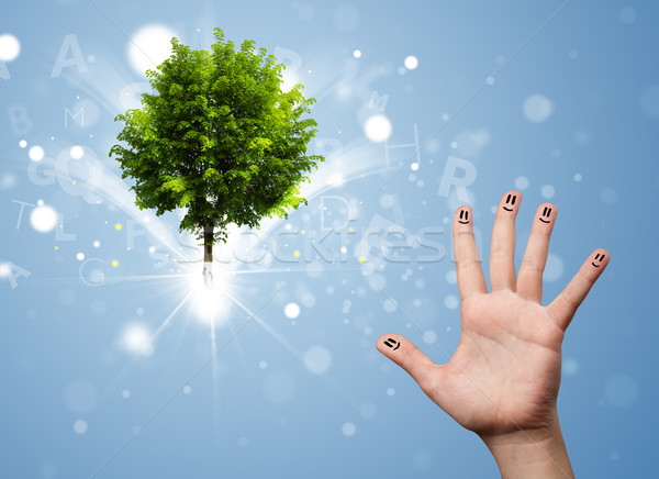 Happy finger smileys with green magical glowing tree Stock photo © ra2studio