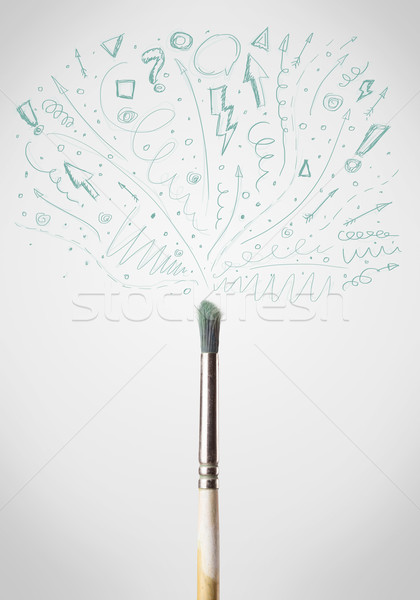Brush close-up with sketchy arrows Stock photo © ra2studio