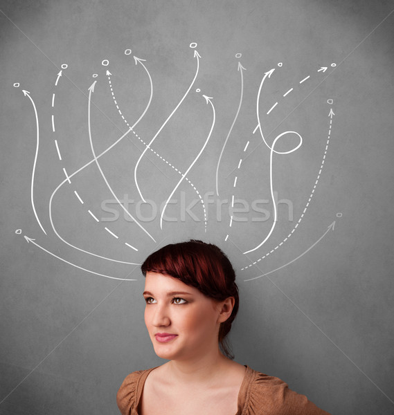 Young woman with arrows coming out of her head Stock photo © ra2studio