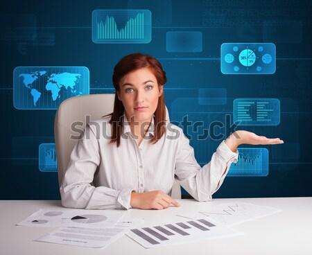 Businesswoman doing paperwork with digital background Stock photo © ra2studio