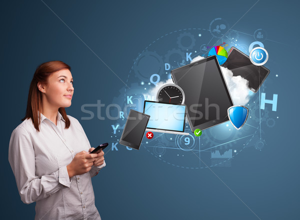 Stock photo: Pretty lady browsing on her smartphone