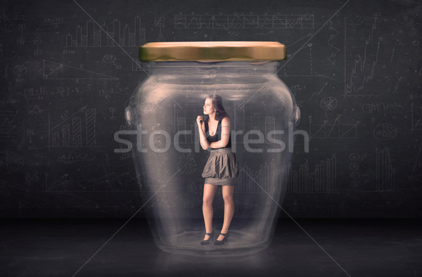 Businesswoman shut inside a glass jar concept Stock photo © ra2studio