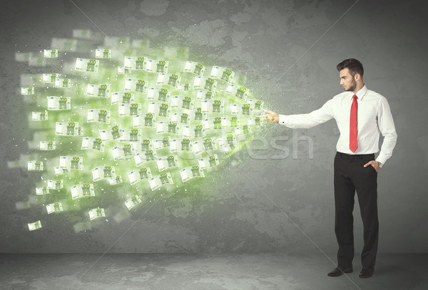 Young business person throwing money concept Stock photo © ra2studio