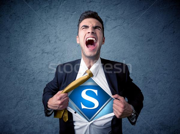 Businessman ripping off his shirt with superhero sign  Stock photo © ra2studio