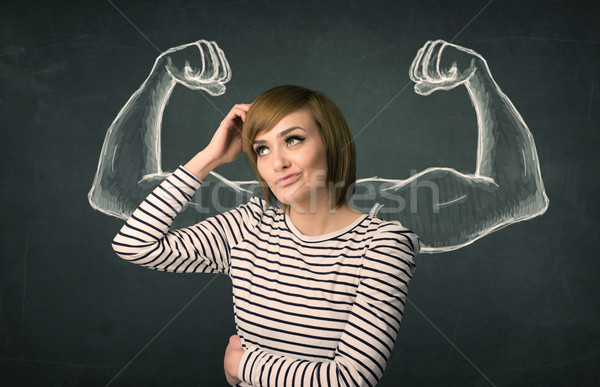woman with sketched strong and muscled arms Stock photo © ra2studio