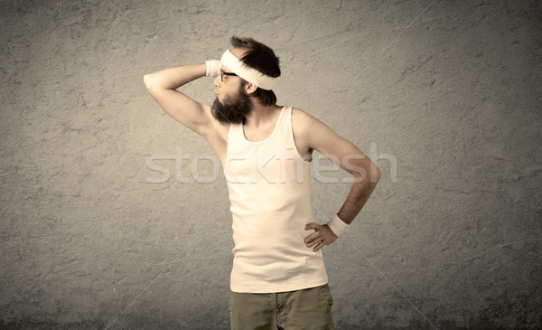 Young male showing muscles Stock photo © ra2studio