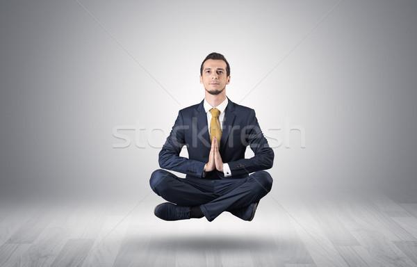 Zakenman vergadering yoga positie lege Stockfoto © ra2studio