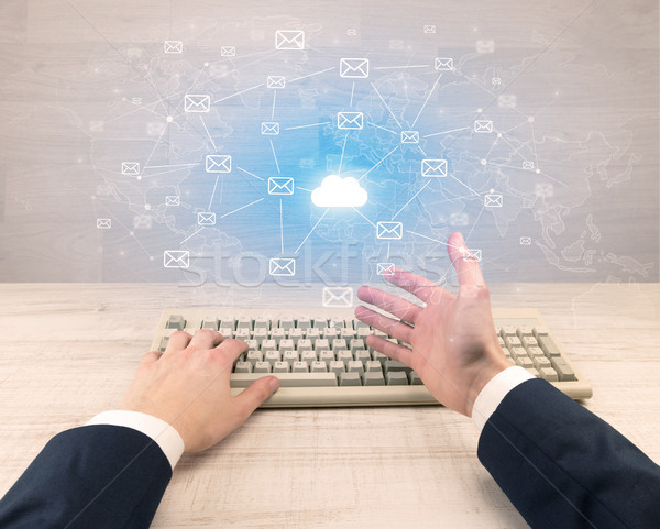 Elegant businessman hand typing with connected mails concept  Stock photo © ra2studio