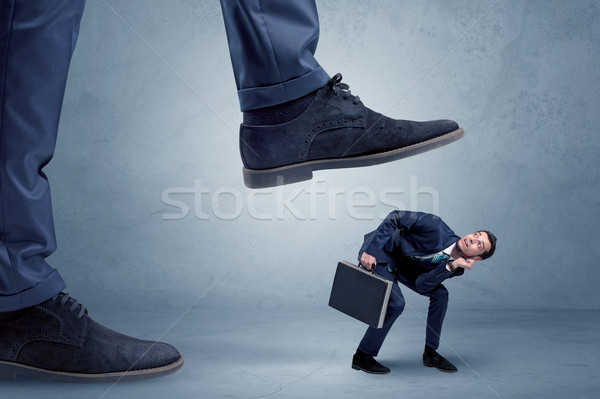 Trampled small businessman in suit Stock photo © ra2studio