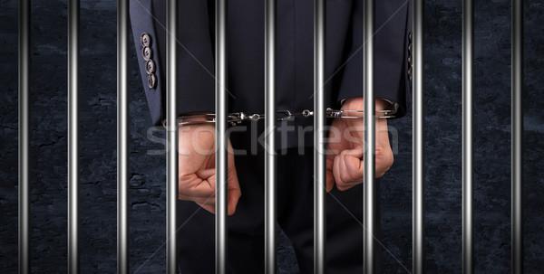Zárt megbilincselve férfi börtön bilincs mögött Stock fotó © ra2studio