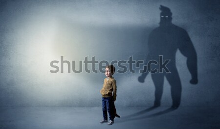 Peril man in front of a crumbly wall Stock photo © ra2studio