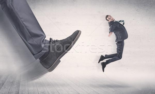 большой ногу огня небольшой бизнесмен черный Сток-фото © ra2studio